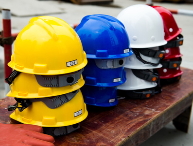 Some construction helmets on work place.